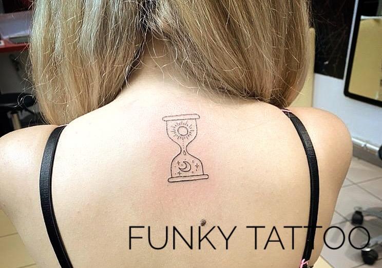tatuaj fete spate salon tatuaje si piercing Funky tattoo Bucuresti