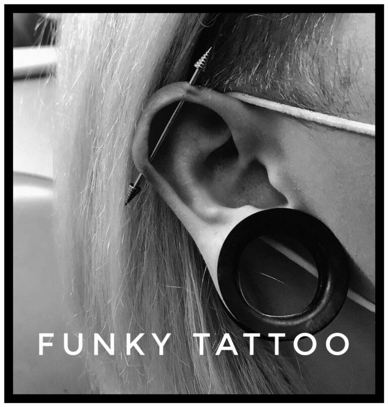 Pierce industrial pierce cartilaj , pierce ureche, salon tatuaje si piercing Funky tattoo Bucuresti