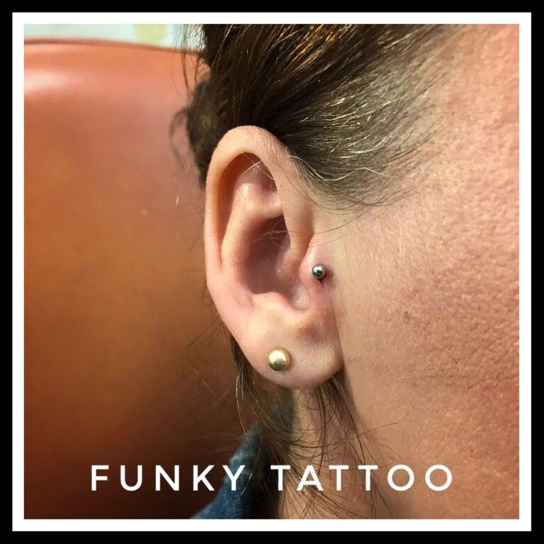 piercing cercel ureche cartilaj tragus salon tatuaje si piercing Funky tattoo Bucuresti