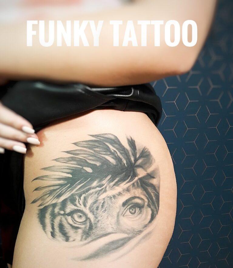 tatuaj fete coapsa tatuaj tigru tiger tattoo girl salon tatuaje si piercing bucuresti